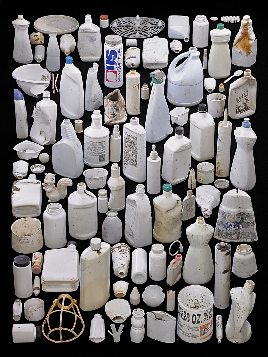 Barry Rosenthal white plastic bottles on a black background